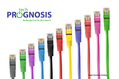 "Image of Ethernet cables in different colors, with the Tech Prognosis logo, and slogan ""We Manage IT So You Don't Have To"" on the top left corner."